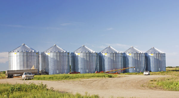 Metal grain silos are ever-present.
