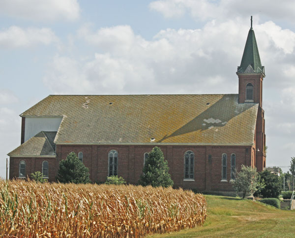 A weathered country chuch in the cornfields.